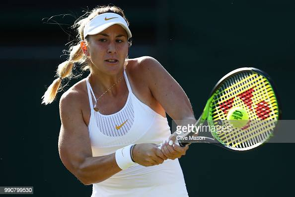 Belinda Bencic of Switzerland returns against Caroline Garcia of France during their Ladies' Singles first round match on day two of the Wimbledon...