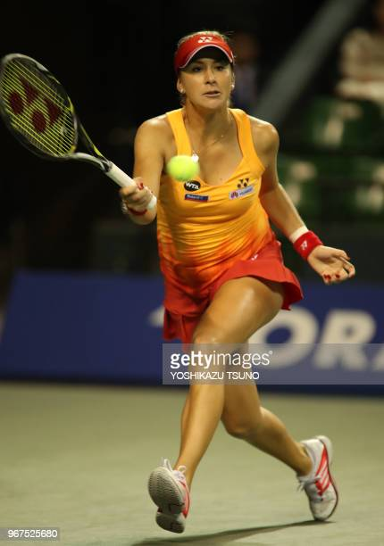 Belinda Bencic of Switzerland returns the ball during the first round of the Toray Pan Pacific Open tennis championships in Tokyo on September 20...