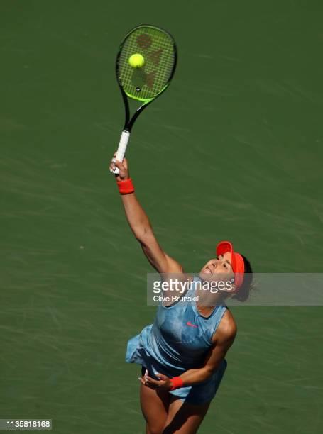 Belinda Bencic of Switzerland serves against Karolina Pliskova of the Czech Republic during their women's singles quarter final match on day eleven...