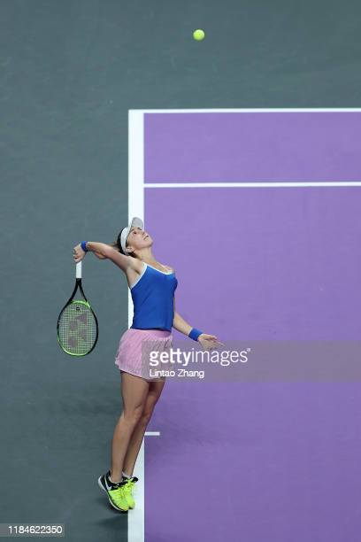 Belinda Bencic of Switzerland serves against Kiki Bertens of the Netherlands during their Women's Singles match on Day Five of the 2019 Shiseido WTA...