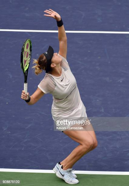 Belinda Bencic of Switzerland serves against Timea Babos of Hungary during Day 3 of the BNP Paribas Open on March 7 2018 in Indian Wells California