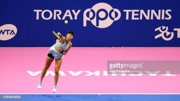 Belinda Bencic of Switzerland serves during her singles first round match against Garbine Muguruza of Spainon day one of the Toray Pan Pacific Open...