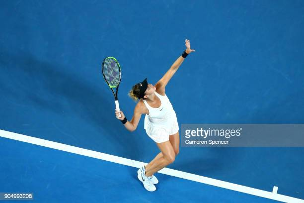 Belinda Bencic of Switzerland serves in her first round match against Venus Williams of the United States on day one of the 2018 Australian Open at...