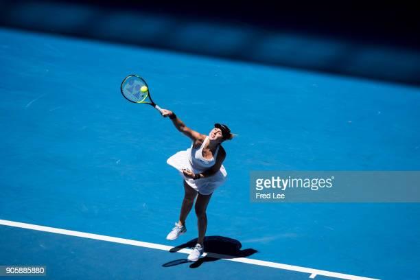 Belinda Bencic of Switzerland serves in her second round match against Luksika Kumkhum of Thailand on day three of the 2018 Australian Open at...