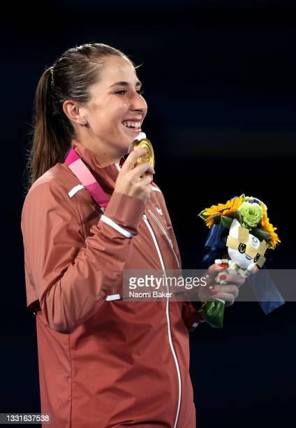 Belinda Bencic of Team Switzerland celebrates with her gold medal after defeating Marketa Vondrousova of Team Czech Republic in the Women's Singles...