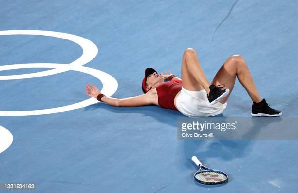 Belinda Bencic of Team Switzerland is celebrates defeating Marketa Vondrousova of Team Czech Republic to win the gold medal after the Women's Singles...