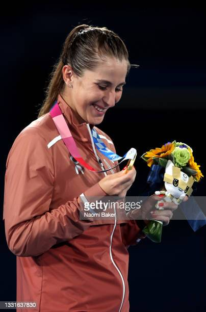Belinda Bencic of Team Switzerland looks at her gold medal during the medal ceremony after the Women's Singles Gold Medal match on day eight of the...