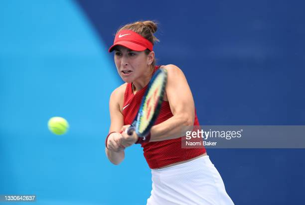 Belinda Bencic of Team Switzerland plays a backhand during her Women's Singles Second Round match against Misaki Doi of Team Japan on day three of...