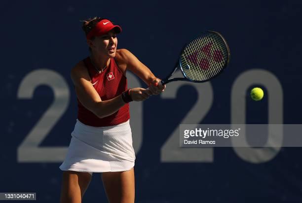 Belinda Bencic of Team Switzerland plays a backhand during her Women's Singles Quarterfinal match against Anastasia Pavlyuchenkova of Team ROC on day...
