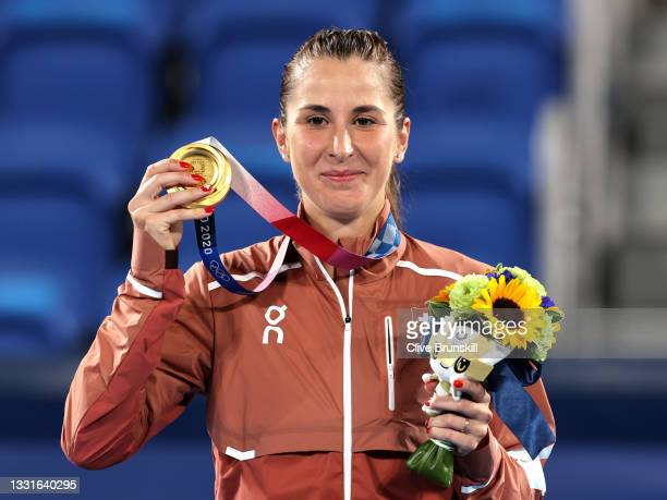 Belinda Bencic of Team Switzerland poses with her gold medal from the podium during the medal ceremony after defeating Marketa Vondrousova of Team...