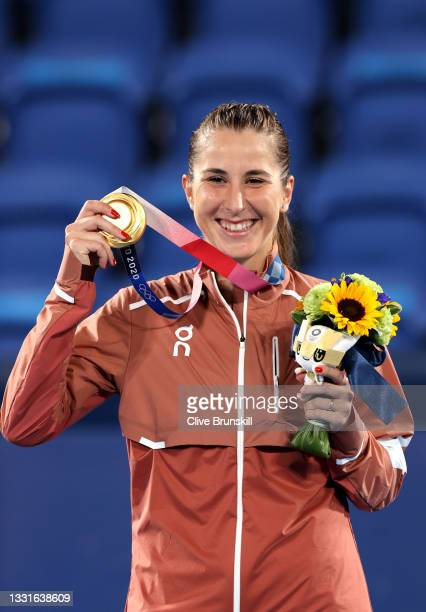 Belinda Bencic of Team Switzerland smiles with her gold medal during the medal ceremony after defeating Marketa Vondrousova of Team Czech Republic in...