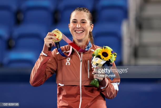 Belinda Bencic of Team Switzerland smiles with her gold medal from the podium during the medal ceremony after defeating Marketa Vondrousova of Team...