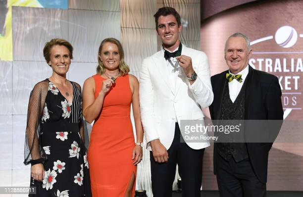 Belinda Clark Alyssa Healy winner of the Belinda Clark Award and Put Cummins the winner of the Allan Border Medal and Allan Border pose during the...
