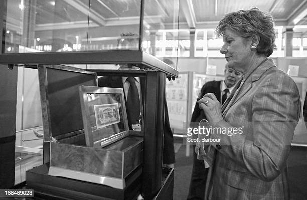 Belinda Downie CEO of Coinworks adjusts the first ever banknote of the Commonwealth of Australia as she prepares to put it on display at the World...
