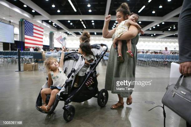 Belinda Gomez stands with her four daughters after her husband from El Salvador was sworn in as a US citizen at a naturalization ceremony on July 25...
