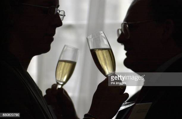 Belinda Green and Simon Leschallas sample champagne at the Banqueting House in London's Whitehall, at what organisers claimed was the world's largest...