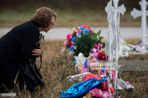 Belinda Morguia of San Antonio visits memorial crosses before attending the Sutherland Springs First Baptist Church service held in a tent on a...