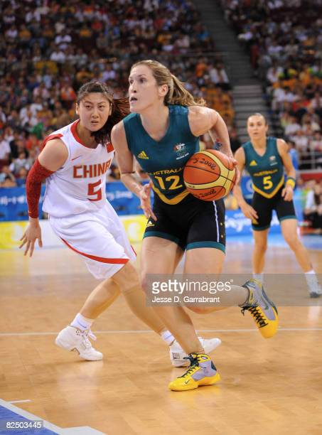 Belinda Snell of Australia drives against Bian Lan of China during the Women's Semifinals basketball game at the Wukesong Indoor Stadium during Day...