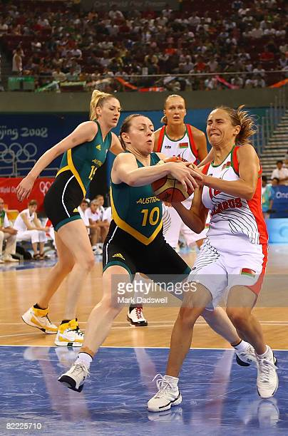 Belinda Snell of Australia fights for the ball with Natallia Marchanka of Belarus in the preliminary women's basketball game at the Beijing Olympic...