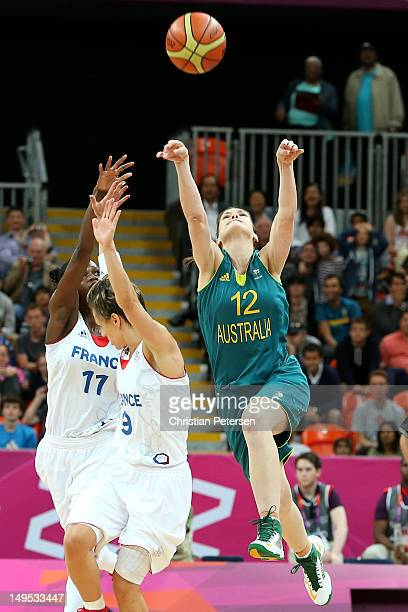 Belinda Snell of Australia hits a game tying three point shot as time runs out over Celine Dumerc of France to force extra time during the Women's...