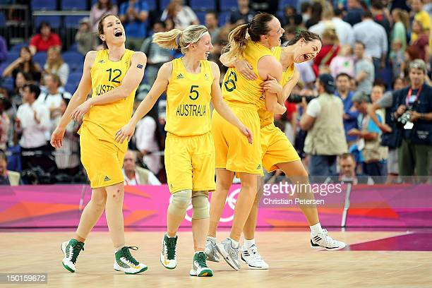 Belinda Snell Samantha Richards Jennifer Screen and Jenna O'Hea of Australia celebrate after they won 8374 against Russia during the Women's...