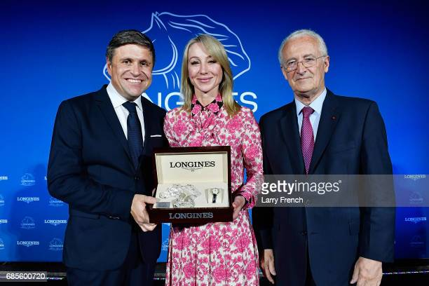 Belinda Stronach receives the Longines Ladies Award from Mr JuanCarlos Capelli Vice President of Longines and Head of International Marketing and Mr...