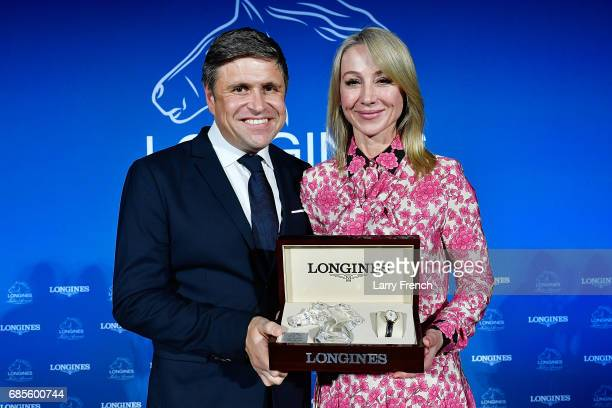 Belinda Stronach receives the Longines Ladies Award from Mr JuanCarlos Capelli Vice President of Longines and Head of International Marketing during...