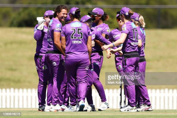 Belinda Vakarewa of the Hurricanes celebrates with her team after taking the wicket of Sophie Molineux of the Renegades during the Women's Big Bash...