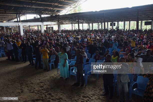 Belivers attend the Sunday mass without wearing masks and social distancing at Ufunuo na Uzima Church in Dar es Salaam on February 7, 2021. - For...