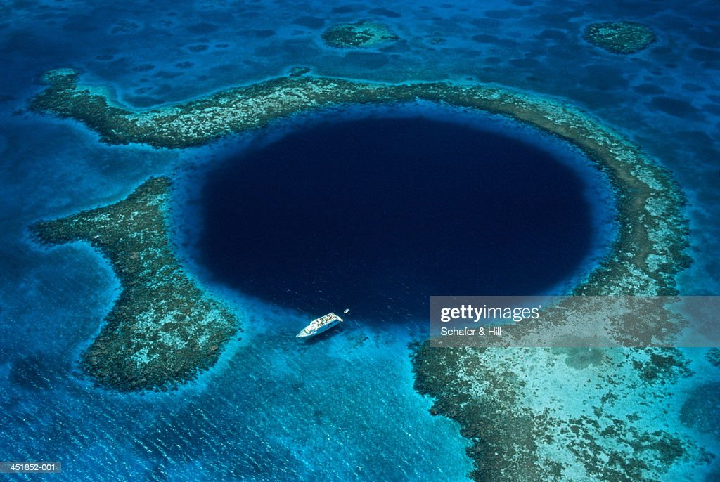 Belize, Lighthouse Reef, boat moored at Blue Hole, aerial view : Stock Photo
