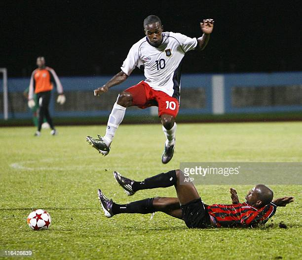 Belize's Boches Harriosn and Monserrat's Mendes Hildyard vie for the ball during their qualification World Cup 2014 football match against Monserrat...
