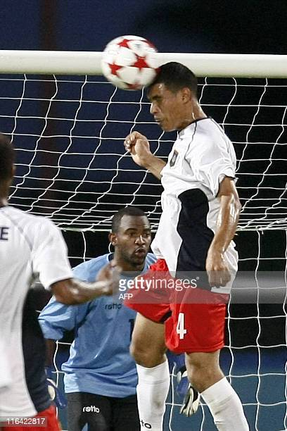 Belize's Eiley Dalton heads the ball during their qualification World Cup 2014 football match against Monserrat at Ato Boldon stadium, Couva,...