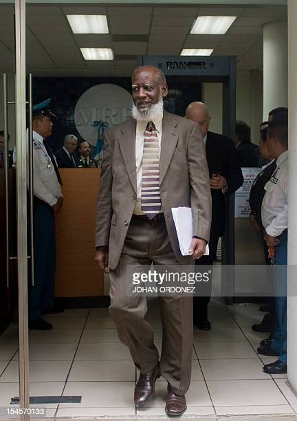 Belize's Foreign Minister Wilfred Elrington arrives for a press conference with the Secretary General of the Organization of American States Chilean...