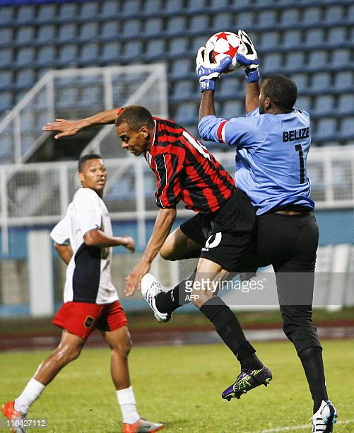 Belize's goal keeper Orio Shane and Monserrat's Hodgson Jay Lee vie for the ball during their qualification World Cup 2014 football match against...