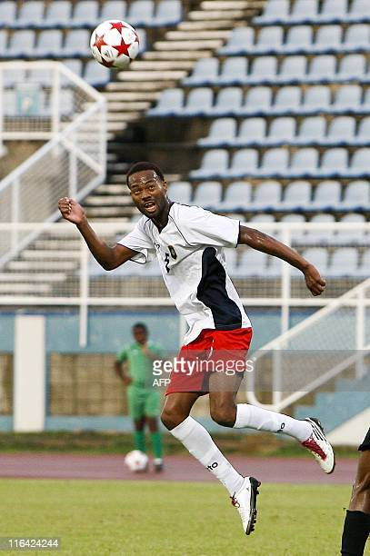 Belize's Kuylen Elroy heads the ball during their qualification World Cup 2014 football match against Monserrat at Ato Boldon stadium Couva Trinidad...