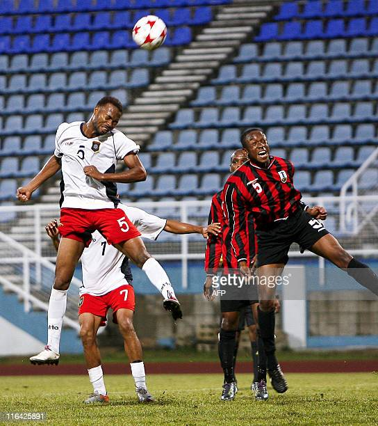Belize's Kuylen Elroy vies for the ball with Allen Kendall of Montserrat during their 2014 World Cup qualifier football match at Ato Boldon stadium,...