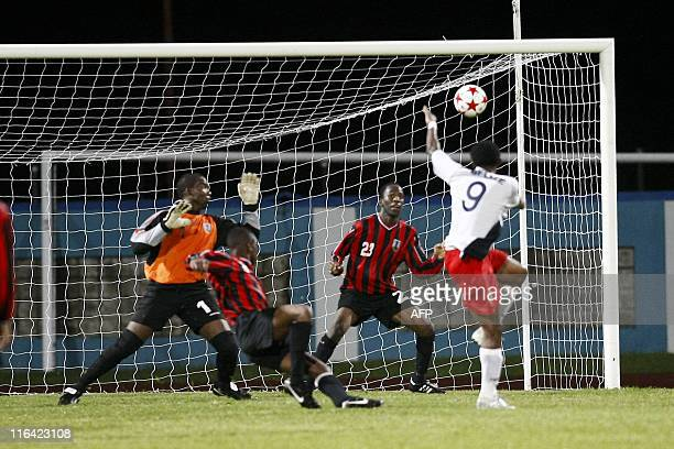 Belize's Mc Caulay Deon heads to score against Montserrat during their qualification World Cup 2014 football match at Ato Boldon stadium Couva...