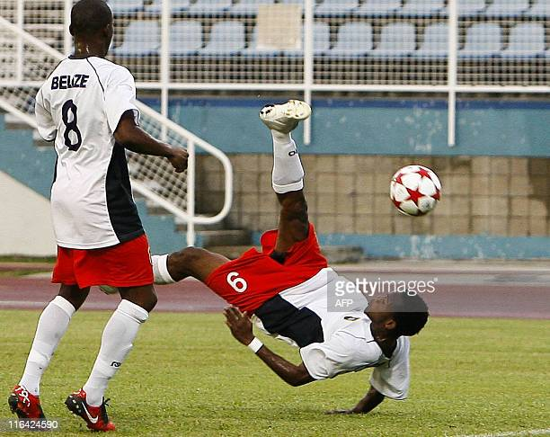 Belize's Mc Cauley Deon makes a bicycle shot during their qualification World Cup 2014 football match against Monserrat at Ato Boldon stadium, Couva,...