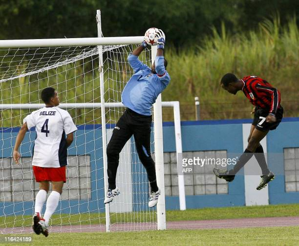 Belize's Orio Shane save his goal after a head shoot from Monserrat's Wade Julian during their qualification World Cup 2014 football match at Ato...