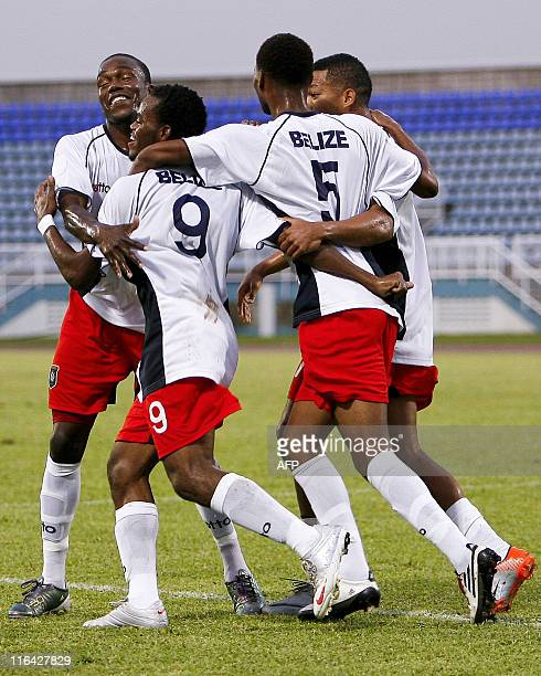 Belize's players celebrate a goal of the team against Montserrat during their 2014 World Cup qualifying football match at Ato Boldon stadium, in...