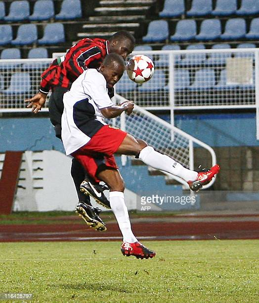 Belize's Smith Elroy vies for the ball with Griffith Anthony of Monserrat during their 2014 World Cup qualifying football match at Ato Boldon stadium...