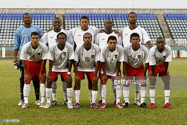 Belize's team poses before the 2014 World Cup qualification football match against Montserrat at Ato Boldon stadium in Couva Trinidad Tobago on June...