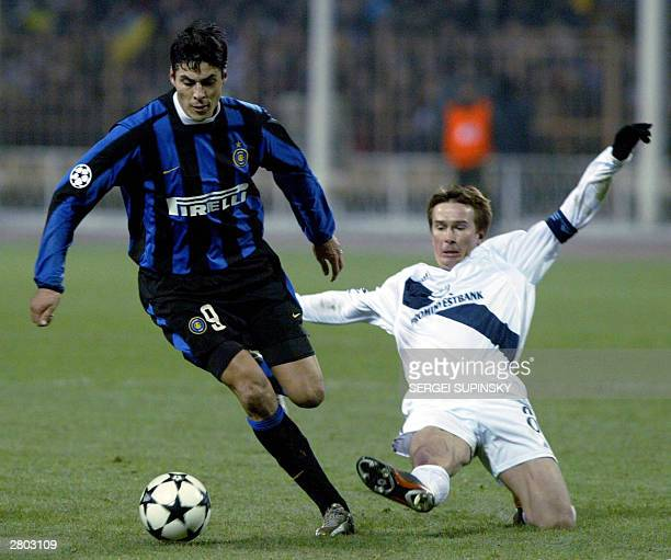 Belkevich Valentin player of FC Dynamo Kyiv fights for a ball against Cruz Julio Ricardo of FC Internazionale during their UEFA Champion's League...