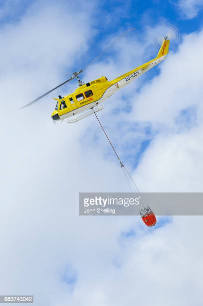 bell 205 firefighting helicopter - helicopter photos stock pictures, royalty-free photos & images