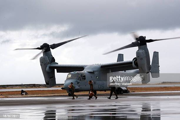 Bell Boeing V22 Osprey arrives at the airport to transport humanitarian workers to typhoon affected areas on November 14 2013 in Tacloban Leyte...