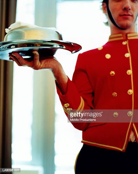 Bell boy holding tray of food