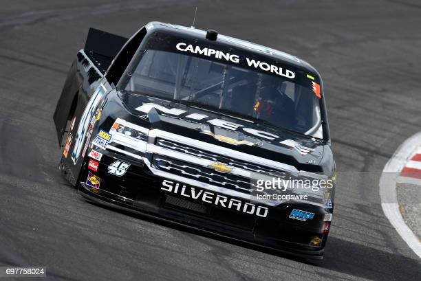 Bell Chevrolet Silverado drives through turn four during qualifying for the NASCAR Camping World Truck Series Drivin' for Linemen 200 on June 17 at...