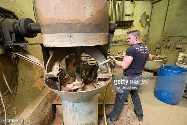 Bell founder trainee Christian Rincker combines loam and straw for a the bell shape for the 'Hamburger Michel' church at the bell foundery Rincker on...
