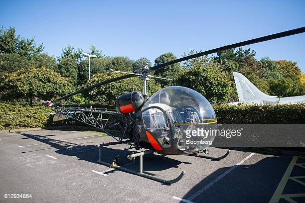 A Bell helicopter sits in the car park outside the Dyson Ltd campus in Malmesbury UK on Wednesday Oct 5 2016 In addition to cordless cleaning...