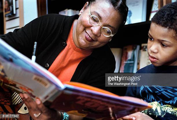 bell hooks signs her book for Robert Wood during the celebration of Karibu Books' 10th anniversary at Prince George's Plaza in Hyattsville MD ORG